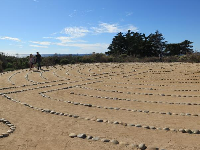 A young couple walks the labyrinth.
