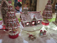 Adorable lit-up gingerbread house.