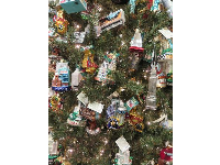 Christmas tree with ornaments representing many cities.
