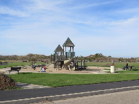 The bike path goes past the playground.