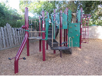 Fun play structure with area like riding a bike.