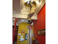 A fireman slides down a pole.