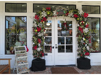Cute Christmas decorations over door at Thomas Hill Organics.