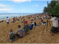 Photographer catching the rides at the Pipeline Masters.