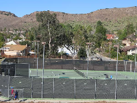 The tennis courts.
