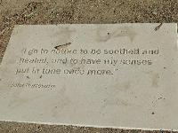 "Plaque outside on the ground. ""I go to nature to be soothed and healed, and to have my senses put in tune once more."" -John Burroughs."