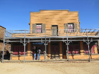 Mustard-colored wild west building.