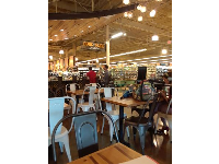 There's plenty of seating (seats are very hard though) inside Whole Foods.