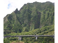 The H3 Freeway hugs the Koolau mountains.