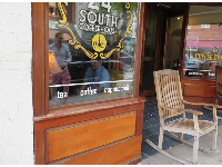 24 South Coffeehouse and wooden rocking chair.