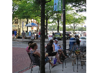 Sitting outside at the corner of Front Street and Market Street, with views of the water.