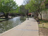 The wide walkway along the canal.