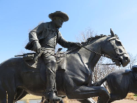Rider, with a hat and boots, in the Centennial Land Run Sculpture.