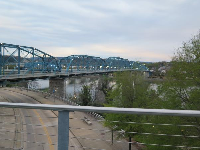 View of the Walnut Street Bridge at night, from the Bluff View Art District.