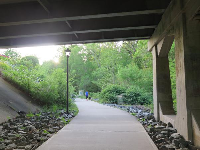 The greenway as it begins at Chapel Hill Community Park, with path underneath Franklin Street.