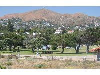 Bike path, picnic area, and hilly backdrop, at San Buenaventura Beach Park.