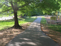 Path past the tennis courts, across Carriage Ridge Way from the greenway.