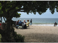 A game of cards in the shade by the sea...
