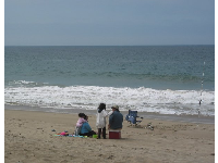 Family fishing on a sunny Saturday in May at Sycamore Cove.