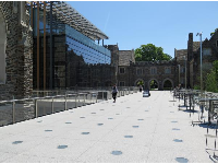 Modern dining commons, in between historic buildings.