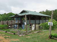 The farm with vegetable beds.
