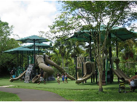 Huge playground with shade umbrellas.