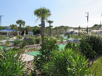 Mini golf and dunes behind.