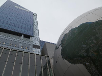 Giant globe which is part of the building.
