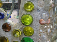 Green bottles and shells in the glass bottle chapel!