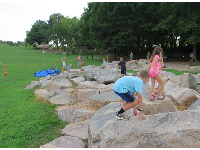 Kids love to climb these boulders behind the stage.