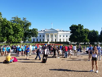 The White House and crowds of people at the North Lawn.