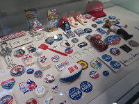 Clinton and Bush campaign items.