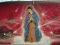 Our Lady of Guadalupe painted on a car.