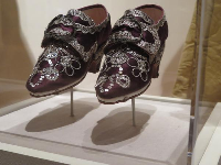 Reproduction of Martha Washington's wedding shoes worn in 1759. Silk with silver trim.