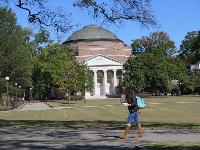 A student walks at the main quad.