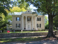 Grand historic home, as seen from the trail that runs along the perimeter of campus.