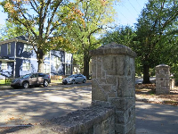 Stone entrance to campus on the Markham Ave (north) side of campus.