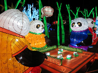 Pandas playing Mahjong!