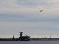 USS Yorktown and helicopter.
