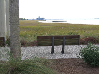 Bench looking past salt marshes to USS Yorktown.