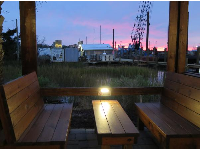 Wooden benches by the marsh grasses, downstairs.