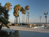 The spacious park where people hang out by the pier.
