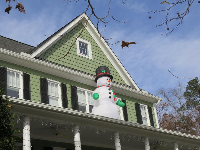 Snowman above the porch!