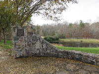 Pond and stone wall.