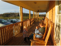 Late afternoon, on the rocking chairs at Maple View Farm.