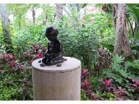 Sweet little statue in the garden.