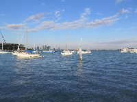 Boats on the water, as seen from Maurice Gibb Park.