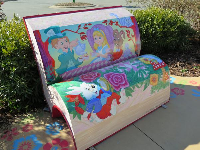 Alice in Wonderland bench in the front garden.