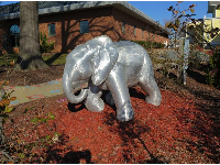 Silver elephant sculpture.