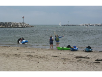 The beach is a bit scungy by the harbor entrance but jet-skiers and kayakers enjoy it.